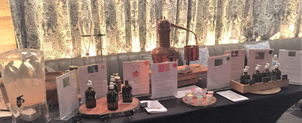 A table with aroma therapy items on it.